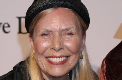Joni Mitchell remains hospitalized, 'continues to improve and get stronger each day'