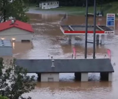 West Virginia floods: At least 20 dead in 'once-in-1,000-year' event