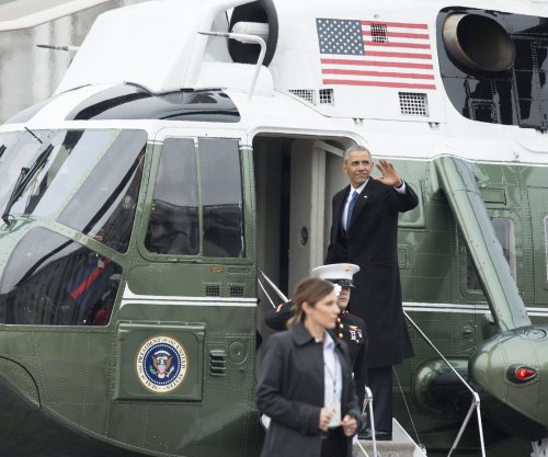 Private meeting marks Obama's Chicago return