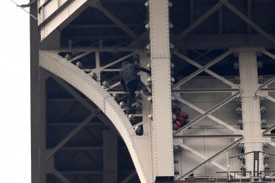 Authorities apprehend man who scaled Eiffel Tower, landmark to reopen