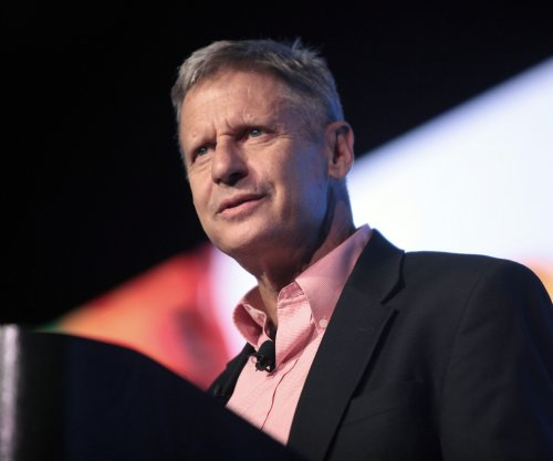 Libertarian Johnson pushes national sales tax to woo Republicans