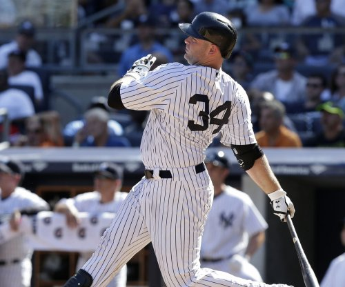 Brian McCann helps New York Yankees rally past Kansas City Royals