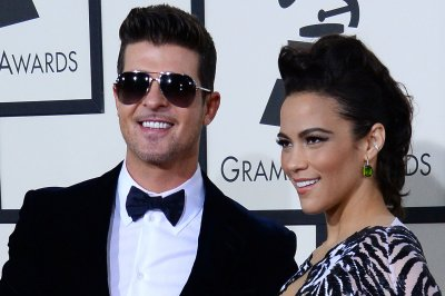 Paula Patton accuses Robin Thicke of domestic abuse in ongoing custody battle