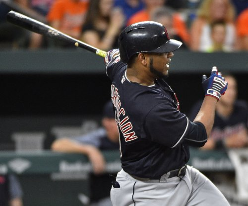 Edwin Encarnacion's 2 HRs power Cleveland Indians past Boston Red Sox
