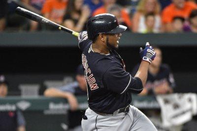 Edwin Encarnacion's 2 HRs power Cleveland Indians past Boston Red Sox