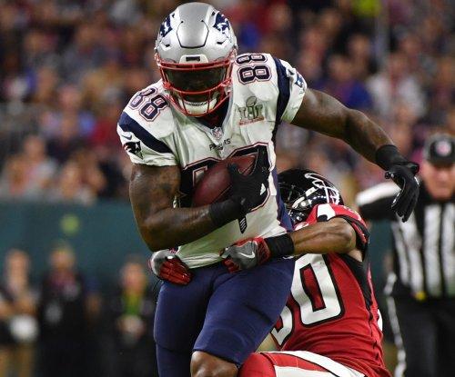 Patriots release TE Bennett, WR Reedy