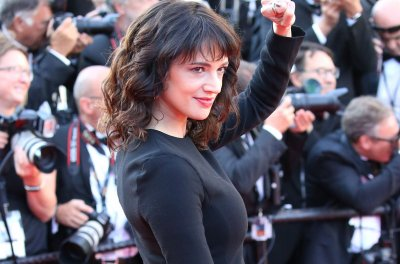 Asia Argento calls Anthony Bourdain, 'my love, my rock, my protector'