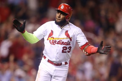 Ozuna giving Cardinals a surge of power vs. Rockies
