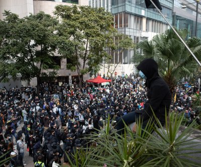 Police injured after making arrests, deploying tear gas at approved Hong Kong rally