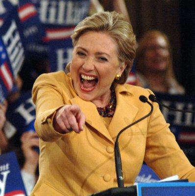 Clinton challenges Obama to four debates