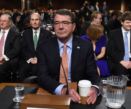 Senate panel unanimously approves Ashton Carter as defense chief