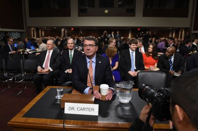 Senate panel unanimously approves Ashton Carter as defense chief