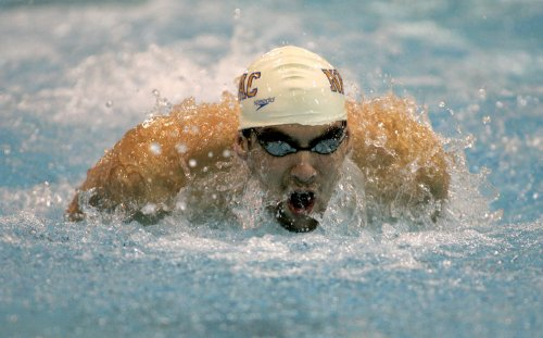Phelps breaks through in 200M butterfly