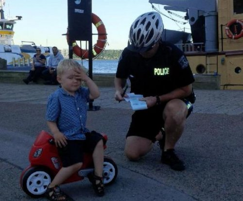 3-year-old gets 'parking ticket' from police in viral photo