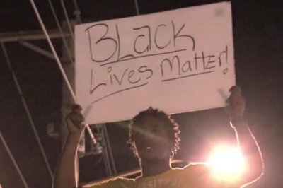 Dozens arrested in overnight Ferguson protests