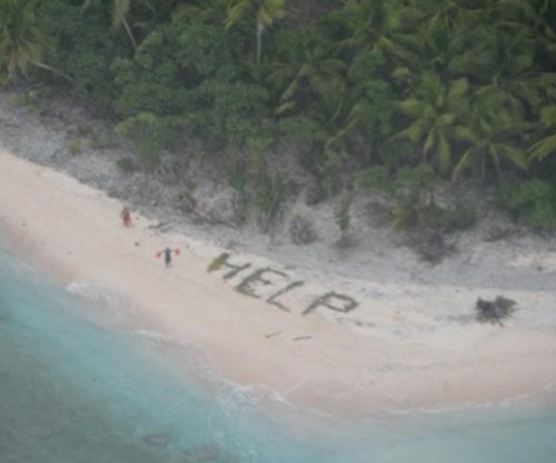 Men rescued from remote Pacific island, 'Help' sign made from palm fronds