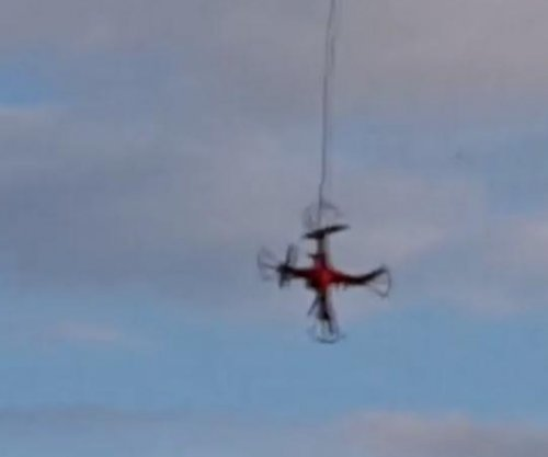 Man uses drone to rescue another drone stranded on a roof