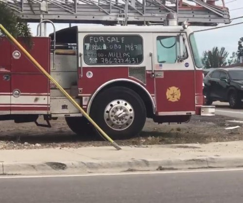 Fire truck for sale at the side of Florida road turns heads