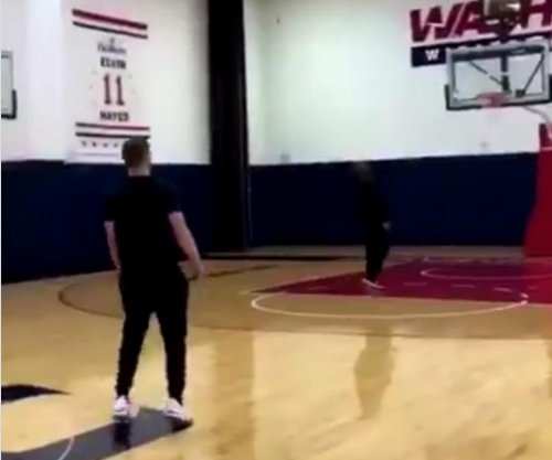 Justin Timberlake drills long-range shots on Wizards' practice court