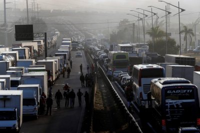 Brazil's president agrees to lower gas prices to end truckers' strike