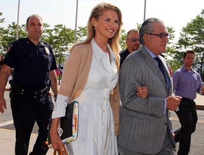 Brinkley, Cook reach settlement in divorce