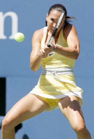 Jankovic rallies to beat Wozniacki