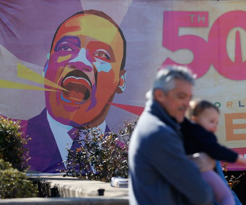 Americans honor Martin Luther King Jr. with marches and service, President Obama volunteers