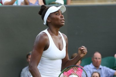 Williams sisters win on hottest day in Wimbledon history