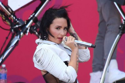 Demi Lovato says 'Father' is about her 'abusive' dad