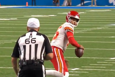 Kansas City Chiefs' Patrick Mahomes stares down ref during 25-yard run