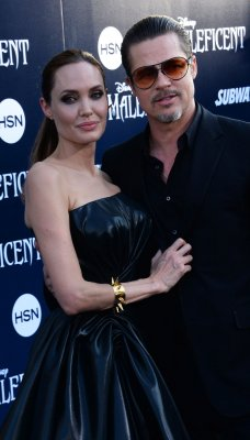Brad Pitt attacked by red carpet prankster during 'Maleficent' premiere