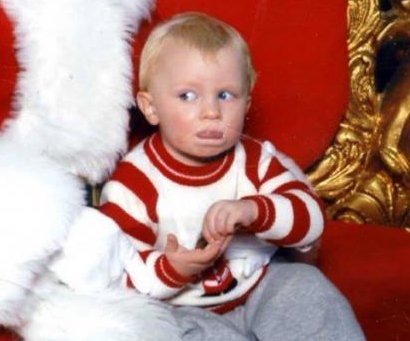 Baby uses sign language to call for 'help' from Santa's lap