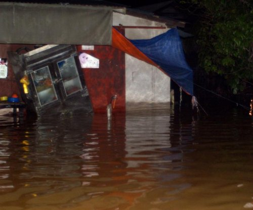 Floods strike Malaysia, killing 5, displacing over 100,000