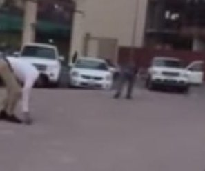 Motorists run into the street to catch flying cash in Kuwait