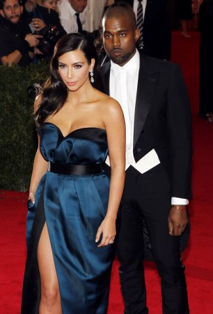Kim Kardashian and Kanye West spotted leaving movie theater during honeymoon