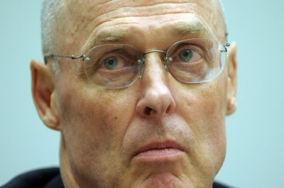 Paulson defends pressuring bank