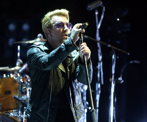 U2 'devastated' by terror attacks in Paris, postpones Saturday's concert