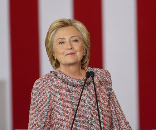 Hillary Clinton back on campaign trail, says millions can't afford sick time
