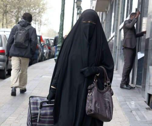 Quebec judge temporarily blocks face-covering law