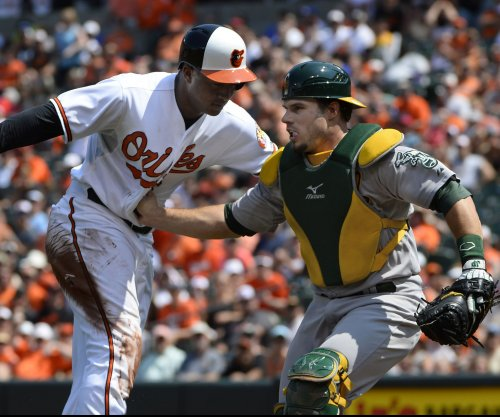 Angels, A's seek series win after splitting two games