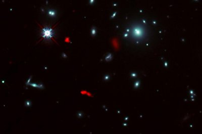 ALMA detects rotating infant galaxy with assist from gravitational lens