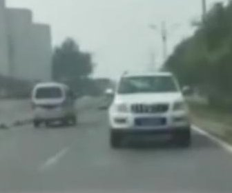 SUV drives backward at a high speed on Chinese road