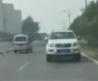 SUV drives backward at a high speed on Chinese road