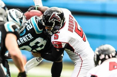 Falcons punter Matt Bosher destroys Panthers' Kenjon Barner on kickoff