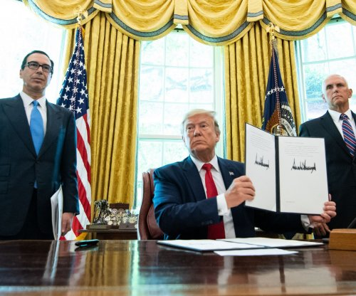 Trump signs new sanctions against Iranian leaders