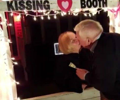 Woman named Loving opens Valentine's kissing booth in front yard