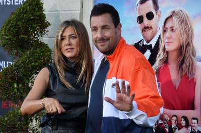Adam Sandler's wife critiqued his on-screen kiss with Jennifer Aniston