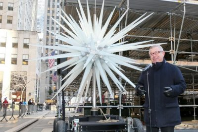 Swarovski tree topper with 3M crystals placed atop Rockefeller tree