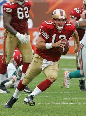 Singletary chooses Hill as quarterback