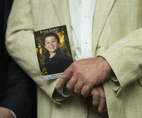 Familes of Sandy Hook school shooting victims sue gunmaker